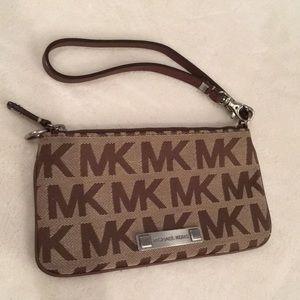 Michael Kors wristlet w/ zipper. Never used